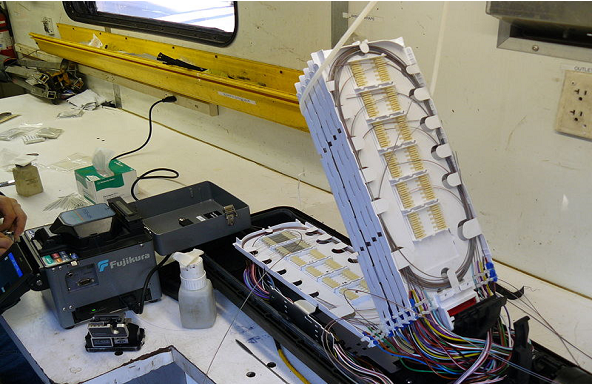1559_An underground fiber optic splice enclosure opens for splicing.png